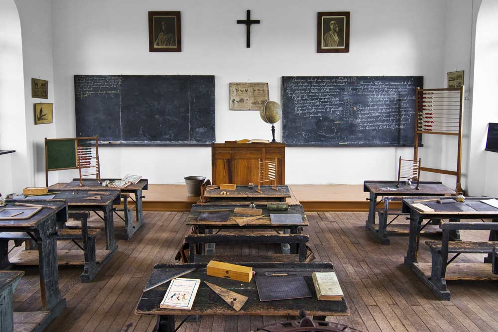 The classroom is likely from the 20s