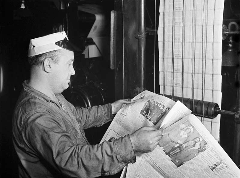 New York Times - 1942-pressman checking newspaper for defects