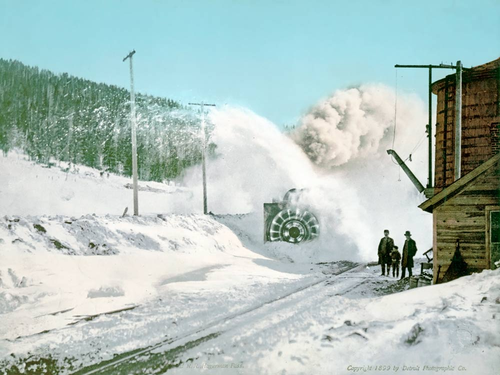 old photo of a snow plow keeping the train tracks snow-free