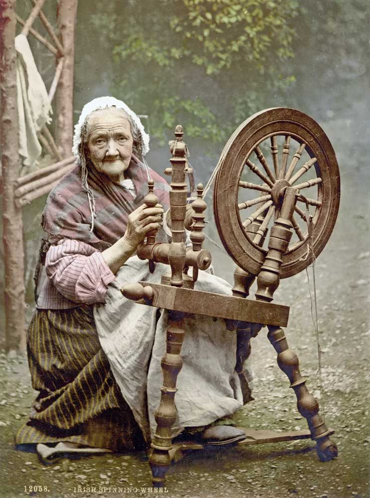 Old postcard of spinning wheel