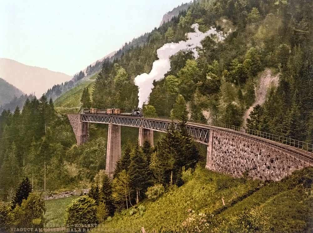 old postcard of a scenic train in the mountains