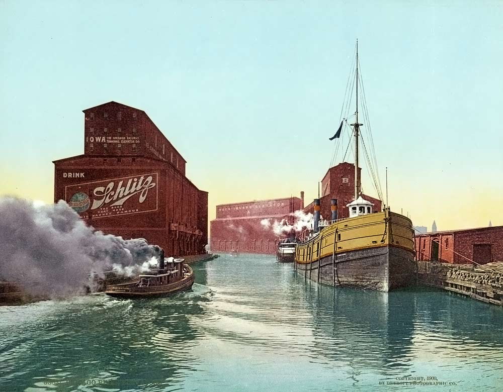 old postcard of the Chicago river with grain elevators