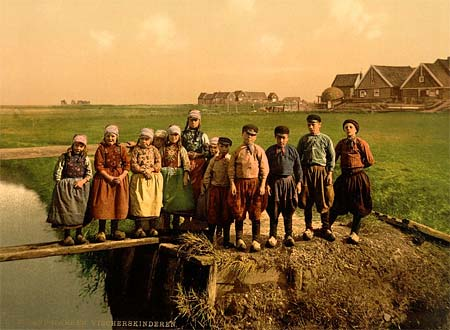 An old postcard of kids in Holland, printed using the Aac process