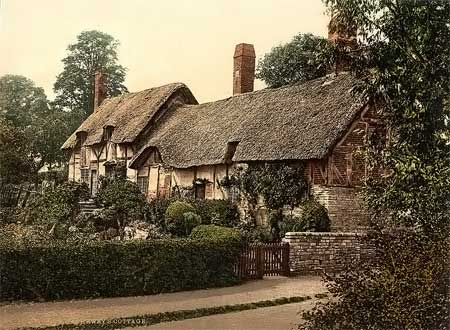 A historical photograph of a cottage in Stratford upon Avon, England