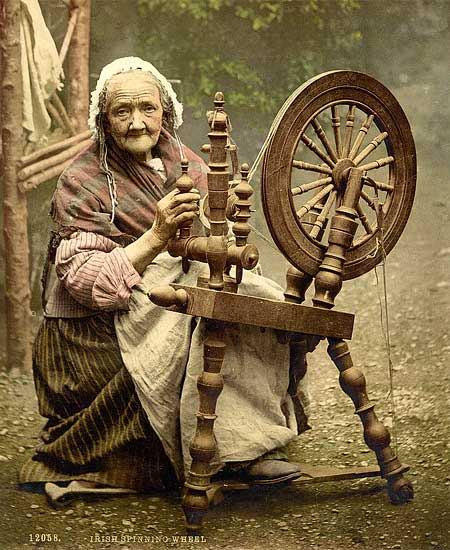 Historical photograph of an old Irish lady spinning wool