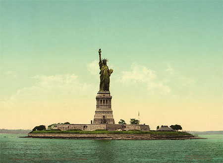 An old postcard showing the Statuse of Liberty in New York, USA