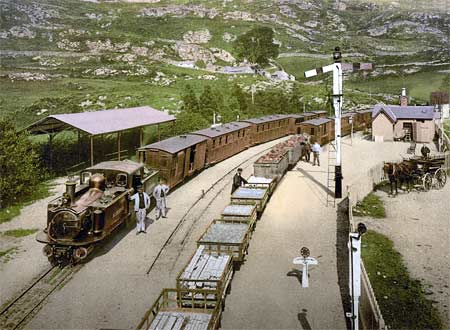 Historic photo of two trains on the Ffestiniog railway in Wales
