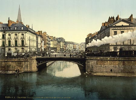 Historic photo of a steam locomotive crossing a bridge in Nantes, France
