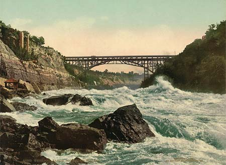 An old postcard of the Whirlpool Rapids, looking up at Niagara in Canada