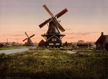 An old postcard of a typical landscape with mills in Holland