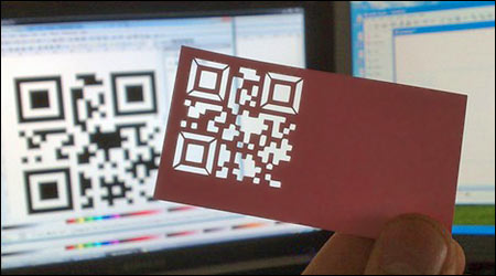 A business card containing a diecut QR code